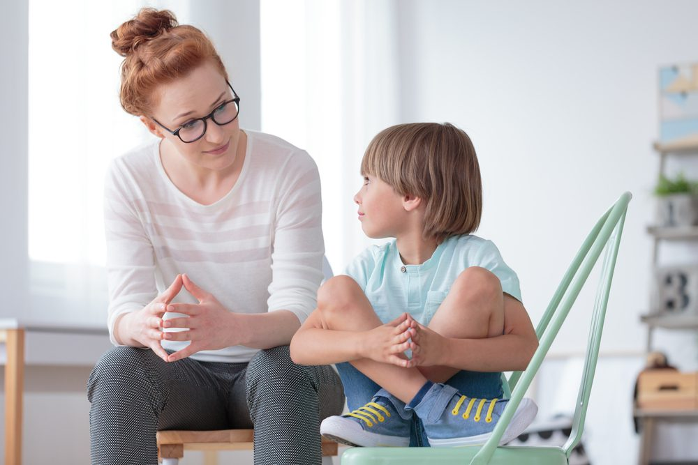 Parent explaining to child about moving home