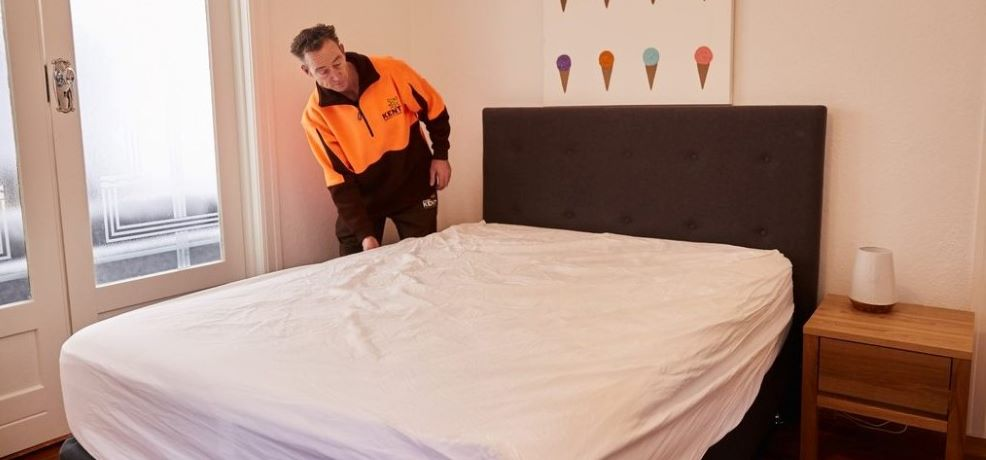 How to take apart a bed frame for storage image