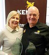Graham Kent presents TheMIGroup service excellence awards to Lisa Fink image